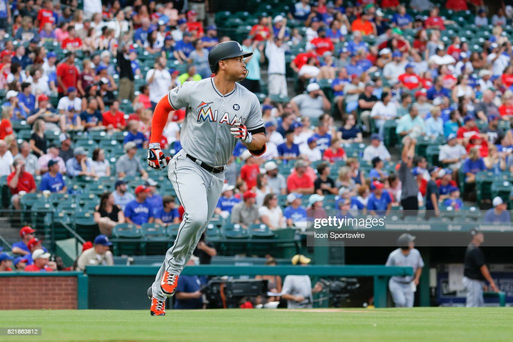 Miami Marlins Right field Giancarlo Stanton (27) hits a 2 run homer run during the 1st inning of the MLB game between the Miami Marlins and Texas Rangers on July 24, 2017 at Globe Life Park in Arlington, TX.