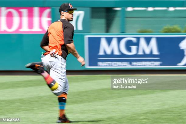 Miami Marlins right fielder Giancarlo Stanton runs in the outfield prior to an MLB game between the Miami Marlins and the Washington Nationals on...
