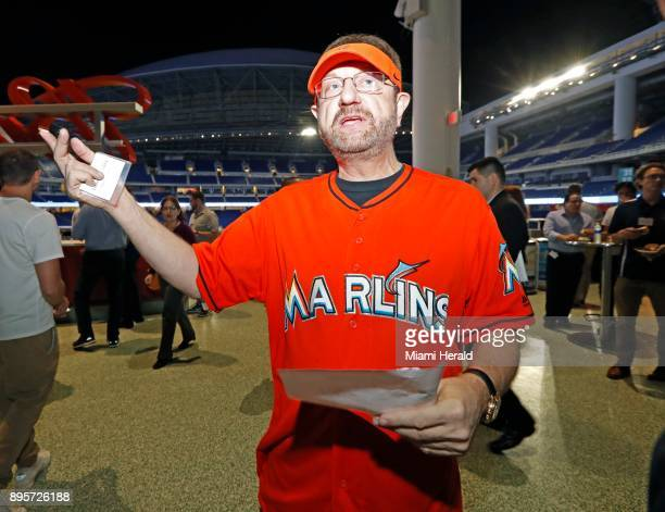 Miami Marlins season ticket holder since 1993 Laurence Leavy speaks to reporters before the team's town hall meeting featuring owner Derek Jeter at...