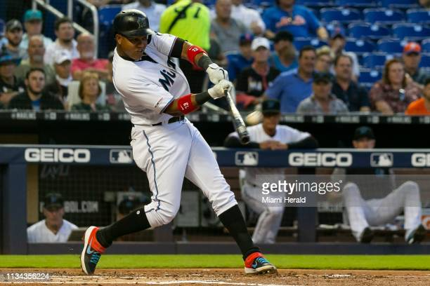Miami Marlins second baseman Starlin Castro hits a two run homer against the New York Mets in the first inning of a baseball game at Marlins Park...