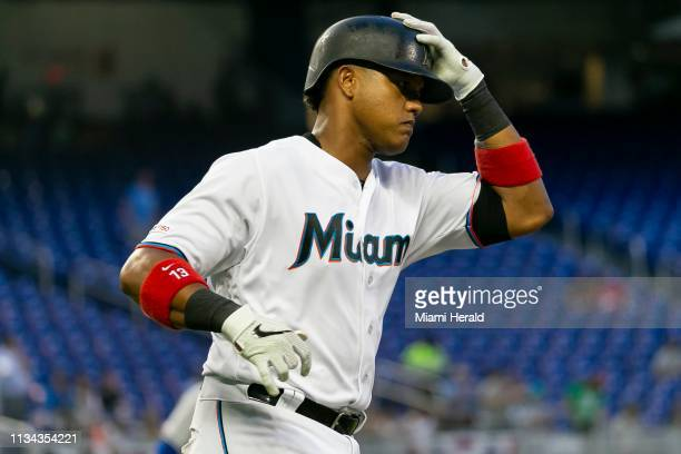 Miami Marlins second baseman Starlin Castro rounds the bases after hitting a tworun homer against the New York Mets in the first inning of a baseball...