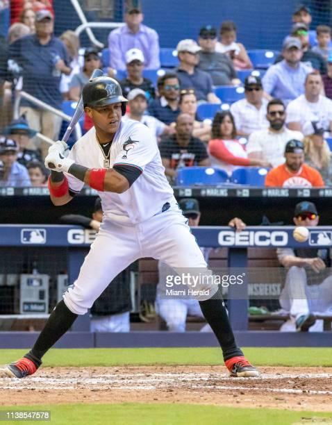 Miami Marlins second baseman Starlin Castro swings at the ball before being walked during the seventh inning against the Washington Nationals on...