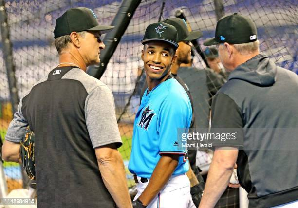 Miami Marlins second round draft pick Nasim Nunez talks with the coaches including manger Don Mattingly before they play the St Louis Cardinals at...
