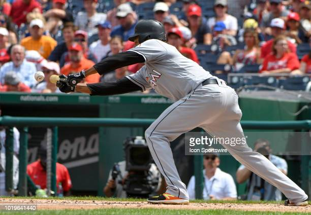 Miami Marlins starting pitcher Jose Urena bunts in the third inning during the game between the Miami Marlins and the Washington Nationals on August...