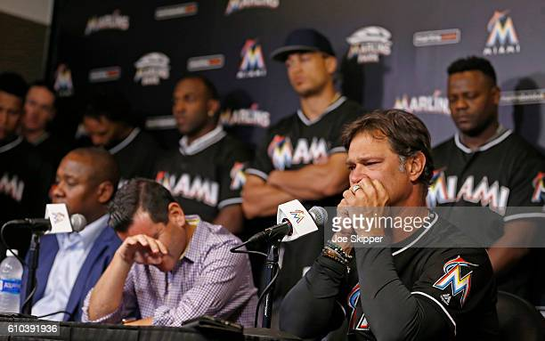 Miami Marlins team president David Samson front center and manager Don Mattingly players appear at a press conference after pitcher Jose Fernanedez...