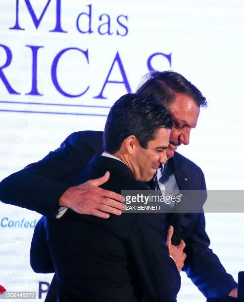 Miami Mayor Francis Suarez gives Brazilian President Jair Bolsonaro the keys to the city during the Forum Of The Americas at the InterContinental...