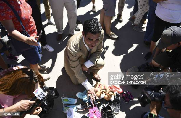 Miami mayor Francis Suarez looks at shoes left by people at the Tornillo Port of Entry near El Paso, Texas, June 21, 2018 during a protest rally by...