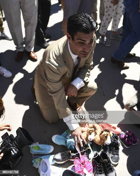 Miami mayor Francis Suarez looks at shoes left by people at the Tornillo Port of Entry near El Paso Texas June 21 2018 during a protest rally by...