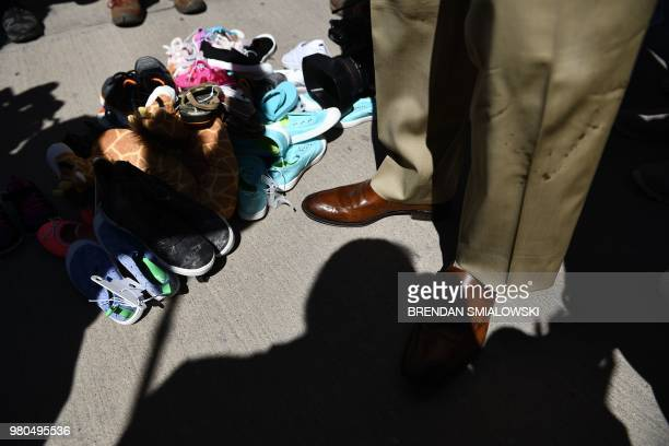 Miami mayor Francis Suarez stands next to shoes left by people at the Tornillo Port of Entry near El Paso, Texas, June 21, 2018 during a protest...