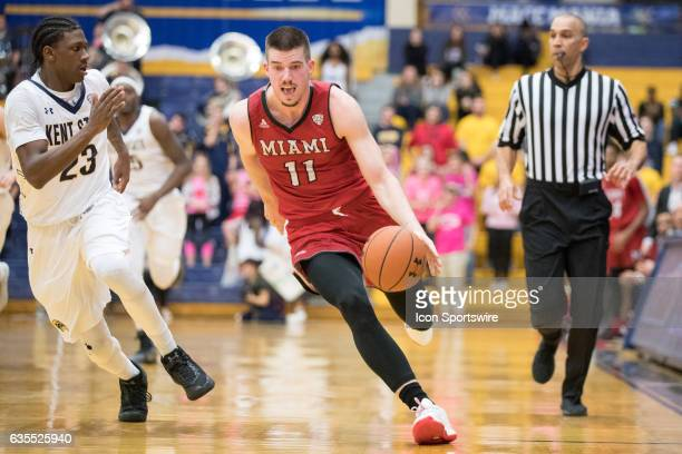 Miami Miami RedHawks F Logan McLane is defended by Kent State Golden Flashes G Jaylin Walker during the first half of the men's college basketball...