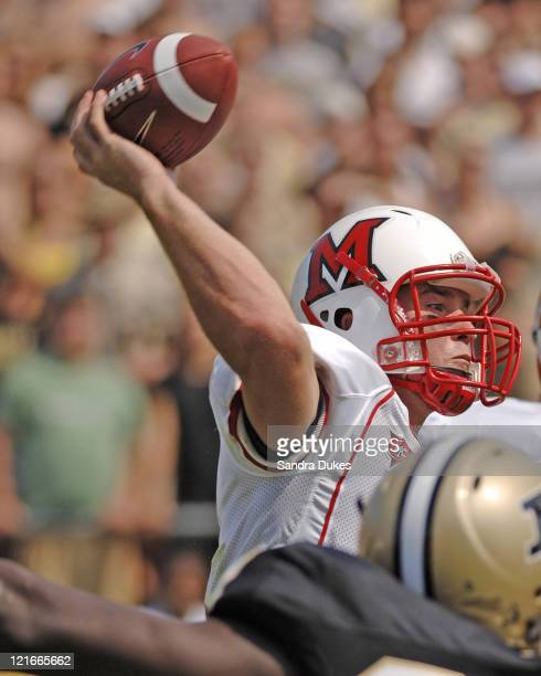 Miami of Ohio's QB Mike Kokal prepares to fire a pass under pressure in Purdue's OT 38-31 win over Miami at Ross Ade Stadium in West Lafayette, IN....