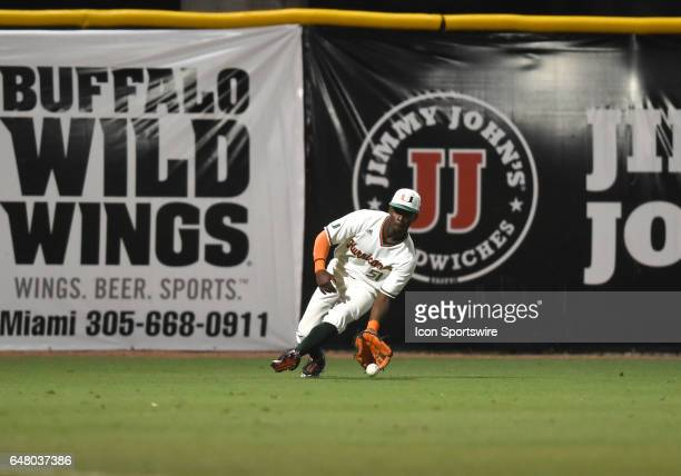 Miami outfielder James Davison fields a single during a college baseball game between the Dartmouth College Big Green and the University of Miami...