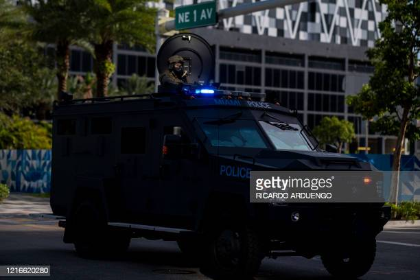 A Miami Police officer watches protestors from a armored vehicle during a rally in response to the recent death of George Floyd in Miami Florida on...