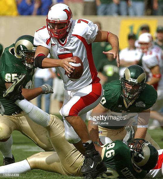 Miami quarterback Ben Roethlisberger eludes the tackles of Colorado States' Terence Carter Bryan Save and Drew Wood during the third quarterSaturday...