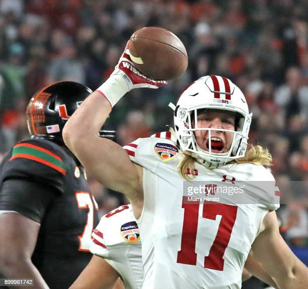Miami quarterback Malik Rosier is intercepted by Wisconsin's Andrew van Ginkel in the second quarter during the Capital One Orange Bowl at Hard Rock...