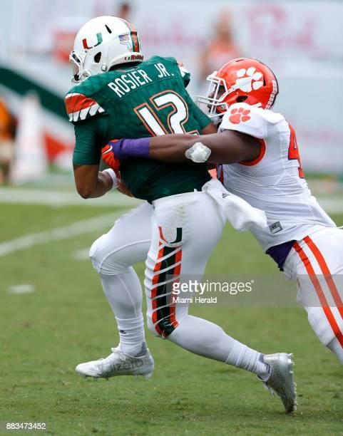 Miami quarterback Malik Rosier is sacked by Clemson's Richard Yeargin at Sun Life Stadium in Miami Gardens Fla on Saturday Oct 24 2015