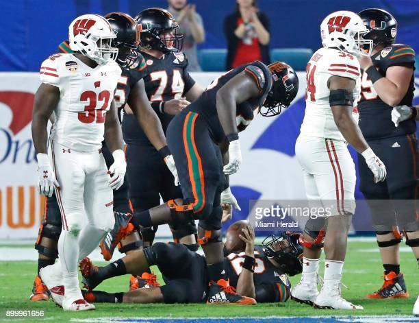 Miami quarterback Malik Rosier is sacked by the Wisconsin in the second quarter during the Capital One Orange Bowl at Hard Rock Stadium in Miami...
