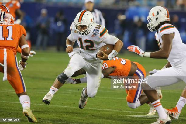 Miami quarterback Malik Rosier runs with the ball during the game between the Clemson Tigers and the Miami Hurricanes on December 2 2017 at Bank of...
