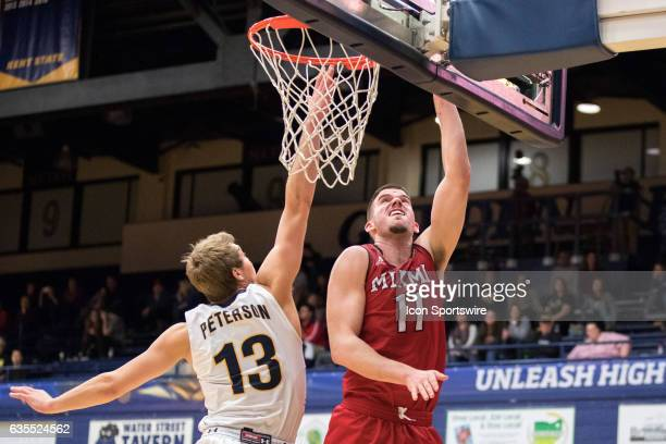 Miami RedHawks F Logan McLane scores against Kent State Golden Flashes G Mitch Peterson during the second half of the men's college basketball game...
