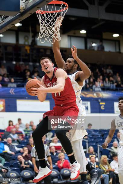 Miami RedHawks F Logan McLane shoots as Kent State Golden Flashes C Adonis De La Rosa defends dduring the first half of the men's college basketball...