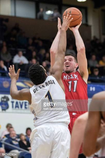 Miami RedHawks F Logan McLane shoots over Kent State Golden Flashes C Adonis De La Rosa during the first half of the men's college basketball game...