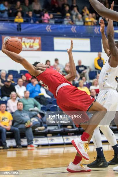 Miami RedHawks F Marcus Weathers reaches back to grab a rebound during the first half of the men's college basketball game between the Miami RedHawks...