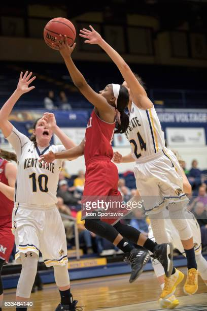 Miami Redhawks G Lauren Dickerson drives to the basket as Kent State Golden Flashes F McKenna Stephens and Kent State Golden Flashes G Alexa Golden...