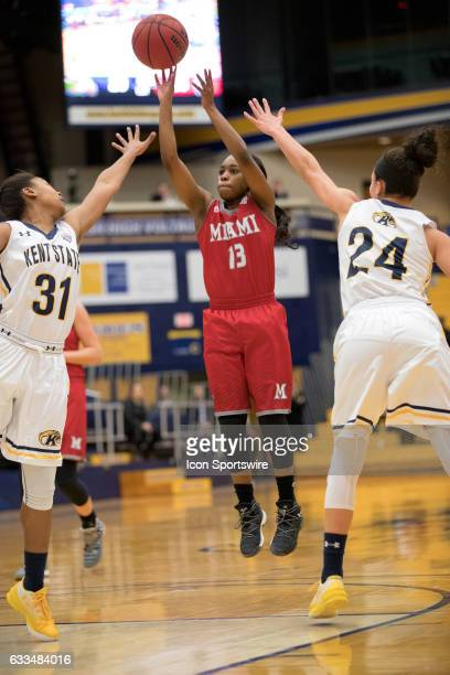 Miami Redhawks G Lauren Dickerson shoots as Kent State Golden Flashes G Megan Carter and Kent State Golden Flashes G Alexa Golden defend during the...