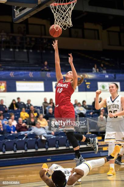 Miami Redhawks G/F Kendall McCoy is called for an offensive foul as she puts up a shot during the first half of the Women's college basketball game...