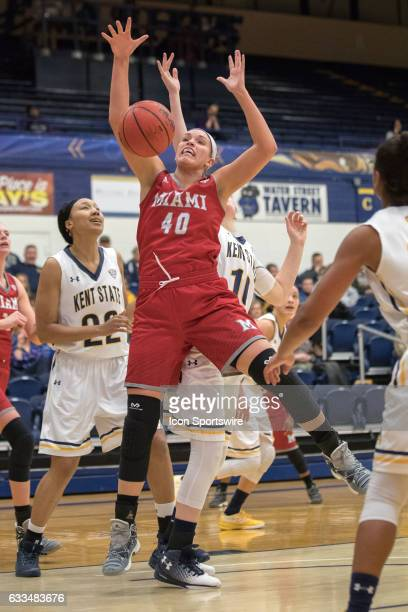 Miami Redhawks G/F Kendall McCoy is fouled by Kent State Golden Flashes F McKenna Stephens during the first half of the Women's college basketball...