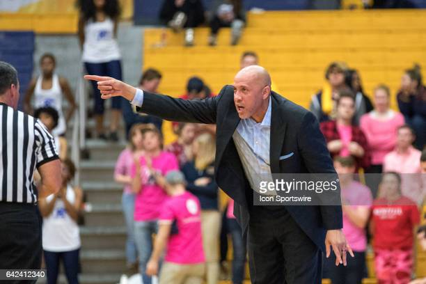Miami RedHawks heac coach John Cooper barks out instructions during the second half of the men's college basketball game between the Miami RedHawks...