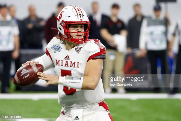 Miami RedHawks quarterback Brett Gabbert looks for a receiver during the MidAmerican Conference championship game between the Miami RedHawks and the...