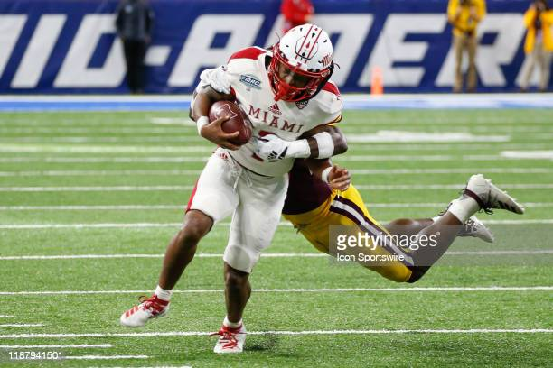 Miami RedHawks running back Jaylon Bester runs with the ball during the MidAmerican Conference championship game between the Miami RedHawks and the...