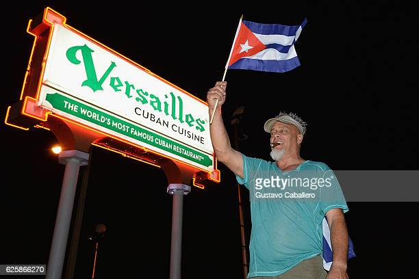 Miami residents celebrate the death of Fidel Castro on November 26 2016 in Miami Florida Cuba's current President and younger brother of Fidel Raul...