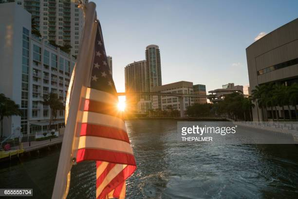 Miami river american flag on sunset