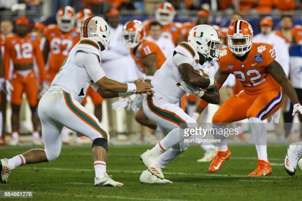 Miami running back DeeJay Dallas takes the handoff from quarterback Malik Rosier during the game between the Clemson Tigers and the Miami Hurricanes...