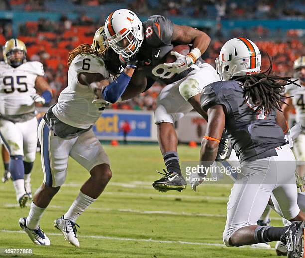 Miami running back Duke Johnson scores on a 17yard pass play in the third quarter against Pittsburgh at Sun Life Stadium in Miami on Saturday Nov 29...