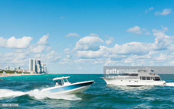 miami scene motor boating in ocean bal harbour haulover beach - haulover beach stock pictures, royalty-free photos & images