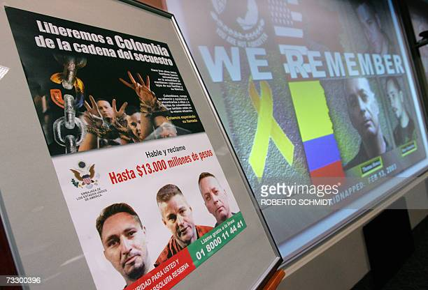 A poster offering money for information about three kidnapped US contractors is displayed 12 February 2007 in Miami Florida during a press conference...