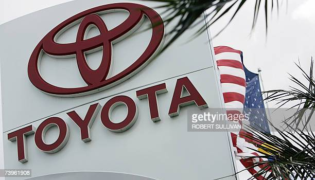 An US flag flies near a Toyota dealership 24 April 2007 in Miami Florida Japan's Toyota Motor Corp became the world's top selling automaker in the...