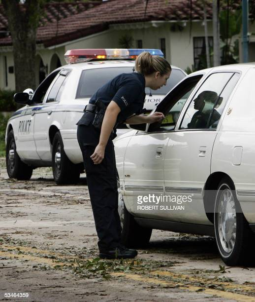 Police check ID's for local access to prevent looting after Hurricane Katrina 26 August 2005 in Miami Florida Many areas are without power Florida...
