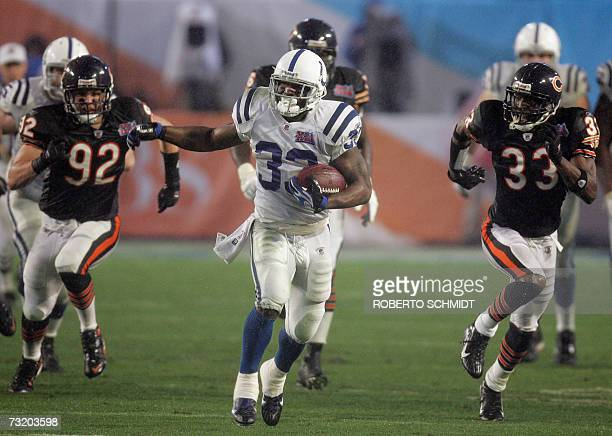 Running back Dominic Rhodes of the Indianapolis Colts outruns Hunter Hillenmeyer and Charles Tillman of the Chicago Bears 04 February 2007 during...