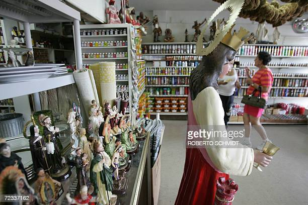 Statues of saints line a sales stand at a Botanica store in Miami Florida 01 November 2006 Christians around the world celebrate All Saints day on...