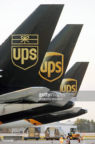 United Parcel Service cargo planes are lined up at the company's air hub for Latin America in Miami Florida 20 October 2006 According to company...