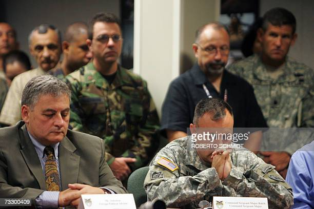 United States Southern Command Sergeant Major Michael Balch joins others in prayer 12 February 2007 in Miami Florida during a press conference...