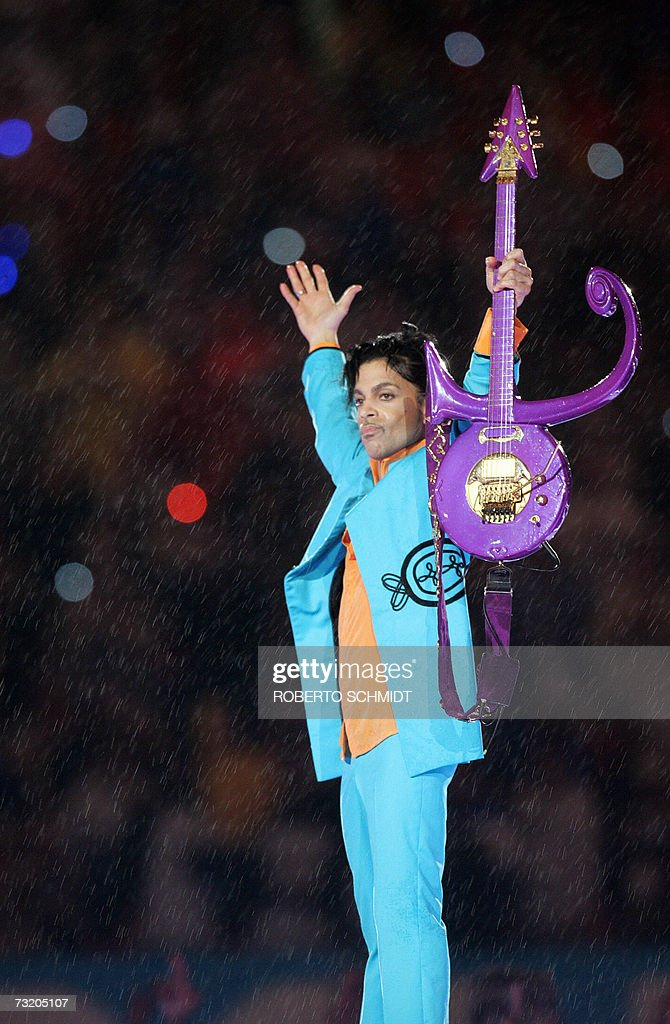 US musician Prince performs during half-time 04 February 2007 at Super Bowl XLI at Dolphin Stadium in Miami between the Chicago Bears and the Indianapolis Colts. AFP PHOTO/Roberto SCHMIDT