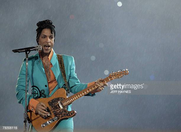 US musician Prince performs during halftime 04 February 2007 at Super Bowl XLI at Dolphin Stadium in Miami between the Chicago Bears and the...