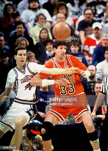 Miami University's Constantine Popa and UConn's Travis Knight battle for the basketball, Hartford CT 1994.