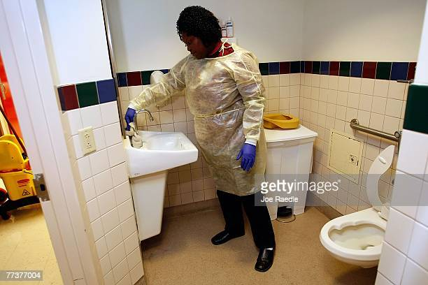 Miami VA Medical Center hospital house keeping aide Shaquina Davis wipes down a patients room with disinfectant October 17 2007 in Miami Florida The...