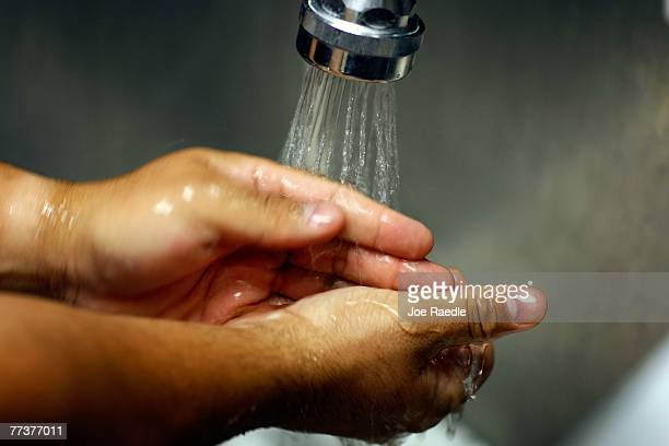 Miami VA Medical Center hospital registered nurse Rafael Sepulveda washes his hands in the sink while attending to patients in the Emergency room...
